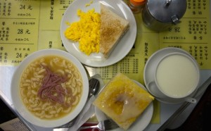Breakfast at Australia Dairy Co.,Hong Kong: macaroni soup with ham, scrambled eggs, toast with sweetened condensed milk, and creamy milk pudding. Photo by Josh Wand