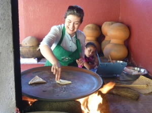 Mary Luz Mejia making tetalas