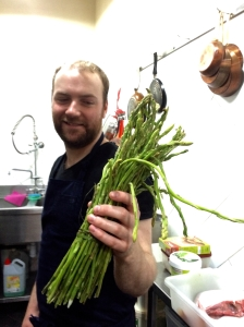 Oliver Truesdale-Poitras showing off his Moroccan asparagus in the kitchen of Restaurant Numéro 7 in Fès, Morocco
