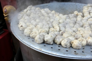 Pork momos steaming at a streetside vendor in Bhaktapur, Nepal; photo by Hilary Duff