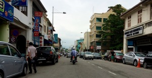 In Georgetown, Malaysia sidewalks are used for parking motorcycles so pedestrians must dodge vehicles on the street