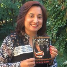 Monica Bhide with her latest novel. Photo courtesy of the author.