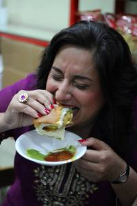 Monica enjoying street food in Dubai. Photo courtesy of the author.