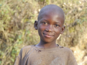 A Batwa boy with a serene smile