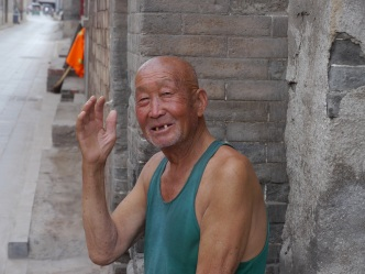 Amused at the tourists, Pingyao. Lowres photo by Johanna Read TravelEater.net